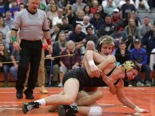Ashland's Matt Taylor beat Tiffin Columbian's Caden Blust in the 126-pound district finals, avenging a loss to Blust in the finals of the J.C. Gorman Invitational.
