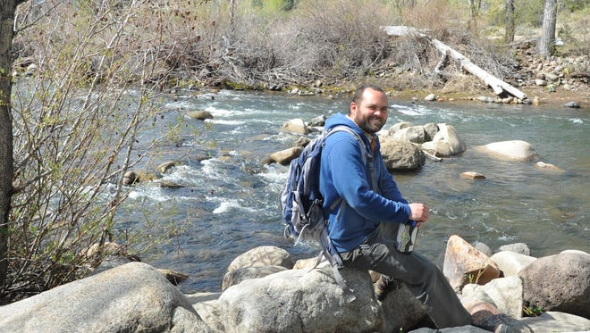 Nate Daniel of the Truckee Meadows Parks Foundation takes a break along the Truckee River at Crystal Peak Park.