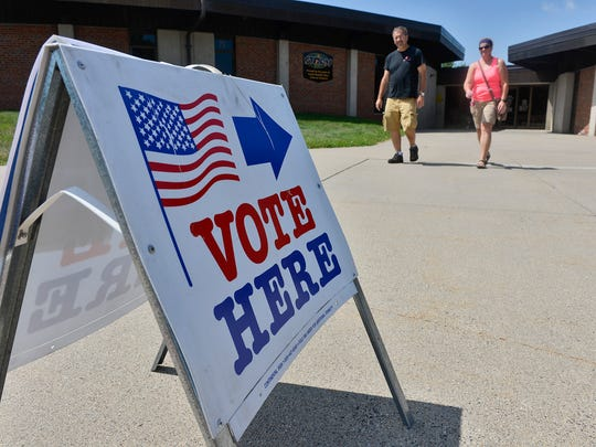 A pair of voters exit the polling station for Sauk