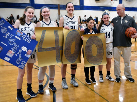 Old Tappan basketball team seniors Erin Harnisch, Sophia Downey, Alex George, Alexis Weisblum and Katie Dunn pose for a picture with Old Tappan girls basketball coach Brian Dunn, after he records his 400th career win. Old Tappan defeated   Paramus Catholic 61-40 on Tuesday, February 20, 2018.