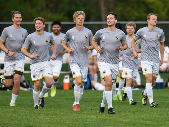 Players warm up before the start of a St. Cloud Dynamo