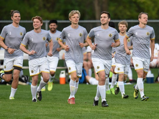 Players warm up before the start of a St. Cloud Dynamo FC game against Waconia Thursday, May 17, at Whitney Park in St. Cloud.