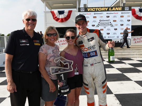 Colin Braun (right) celebrates his victory with (from left) father Jeff, mother Diane and wife Melissa.