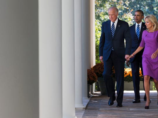 Vice President Joe Biden, with his wife Dr. Jill Biden, and President Barack Obama walk toward the Rose Garden of the White House on Wednesday, Oct. 21, 2015, to announce that Biden will not run for the presidential nomination. (AP Photo/Jacquelyn Martin)