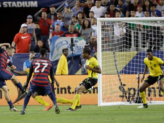 Jordan Morris scores the decisive goal in Team USA's 2-1 win over Jamaica during the Gold Cup final on Wednesday.