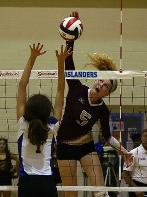 T-M's Bethany Clapp hits the ball against Alamo Heights during their Class 5A Regional Semifinals match at Dugan Wellness Center, A&M-CC Campus on Friday, Nov. 11, 2016.