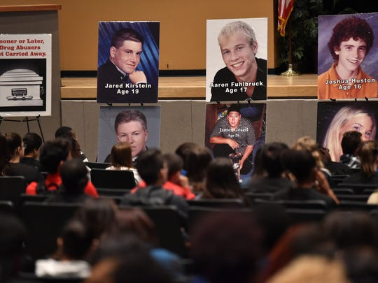 "Portraits of victims from fatal drug overdoses are seen by the junior class at Treasure Coast High School during a NOPE, Narcotics Overdose Prevention and Education, event at the school's auditorium on Nov. 14, 2016, in Port St. Lucie. ""We bring information to our students about the use of drugs and their consequences,"" said Deputy Sergio Lopez, of the St. Lucie County Sheriff's Office, and moderator for NOPE."