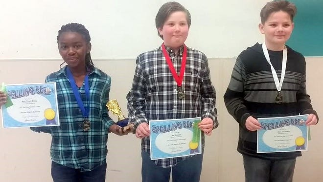 From left, spelling bee fifth-grade champion Nana Lloyd-Mills; second place, Max Johsnon, third grade; third place, Chaz Christmas, fifth grade.