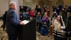 Sen. Robert Menendez speaks to reporters during a news
