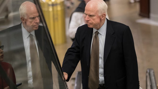 Sen. John McCain, R-Ariz., arrives at the Capitol in Washington, D.C., for a briefing. He and fellow Arizona Sen. Jeff Flake are approaching the newly released Republican health-care bill with caution.