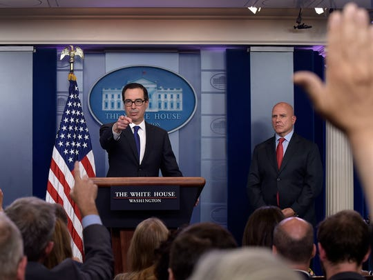 Treasury Secretary Steven Mnuchin calls on a reporter