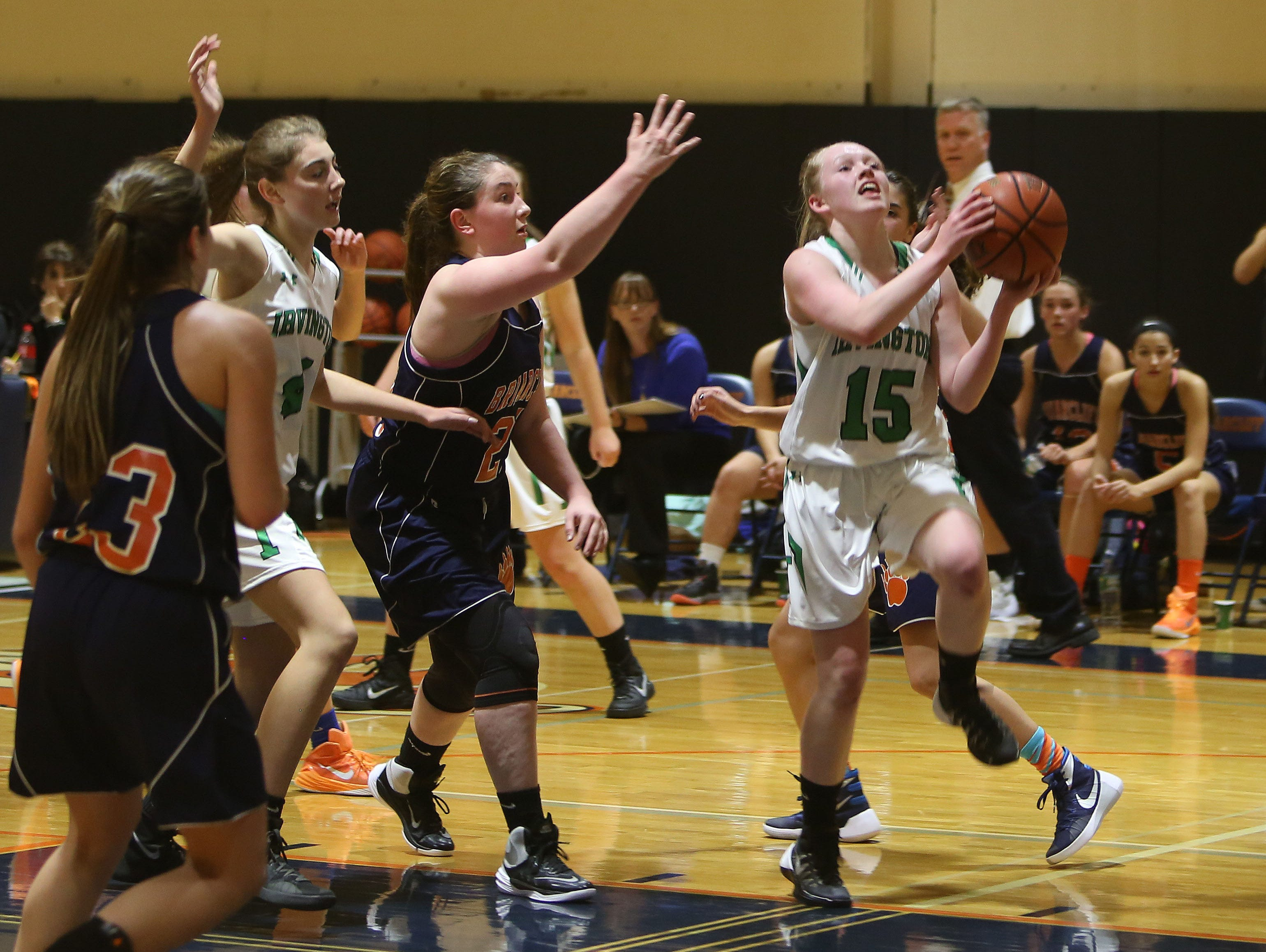 Irvington's Lindsay Halpin (15) drives to the basket against Briarcliff during girls basketball action at Briarcliff High School Dec. 1, 2015. Irvington won the game 71-57.