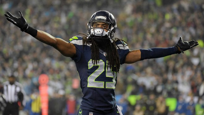 Seattle Seahawks cornerback Richard Sherman (25) reacts after free safety Earl Thomas (29) intercepted a pass last week against the Carolina Panthers.