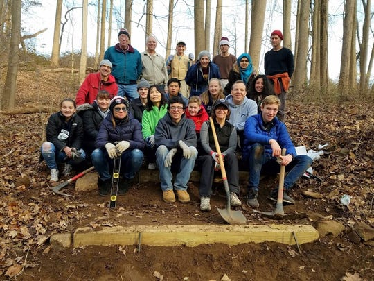 The last Saturday Trail Work Day of 2017 was a success as 26 volunteers stepped out into the cold to install steps in three newly re-routed sections of the Orange Trail in Union County's Watchung Reservation. The steps will help visitors get a close-up view of unique geological features including an ancient lava flow and glacial erratics, the non-native rocks left behind following the retreat of the Wisconsin Glacier. The volunteers also pruned back vegetation that was encroaching into the trail bed, and closed down old trail sections that are no longer in use. Saturday Trail Work Days take place on the first Saturday of every month except January and February. The program will resume March 3. Any individual or group is welcome to join Saturday Trail Work Days and other volunteer activities in Union County Parks. For more information, call 908-789-3683 or visit Adopt-a-Trail/Adopt-a-Park online at ucnj.org/parks.