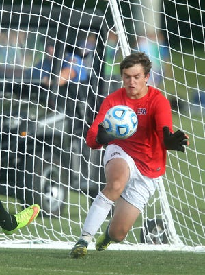 CPA's keeper Garrett Beam (1) deflects a direct kick from Central Magnet's Stephen Falter (22) during the quarterfinals of Class A-AA Soccer Tournament during Spring Fling on Tuesday, May 23, 2017.