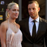 Olympian Oscar Pistorius and girlfriend Reeva Steenkamp in November 2012.