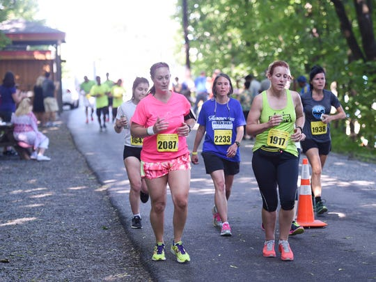 Runners take to the Dutchess Rail Trail during the