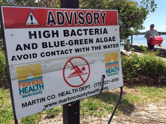 Signs warning of high bacteria levels and algae blooms line the boat ramp and fishing pier Tuesday at Leighton Park in Palm City. Algae blooms are spreading into the main channel of the St. Lucie River, past downtown Stuart to the northern end of Sewall's Point. (MOLLY BARTELS/TREASURE COAST NEWSPAPERS) 