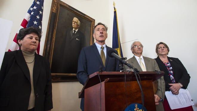 Gov. Peter Shumlin, center, speaks during a news conference in Montpelier on April 14, 2016.