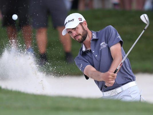FILE - In this March 20, 2016 file photo, Troy Merritt hits the ball out of a bunker during the final round of the Arnold Palmer Invitational golf tournament in Orlando, Fla. Merritt is the defending champion at the Quicken Loans National, but that doesn't mean he gets friendly vibes from the golf course. Merritt shot 14 under par on the weekend last year at Robert Trent Jones Golf Club to break through for his first PGA Tour victory, beating Rickie Fowler by three shots.  (AP Photo/Willie J. Allen, Jr.)