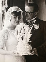 This photograph shows Betty Kasdorf with the topper at her wedding to husband Jim Kasdorf on April 24, 1965.