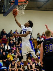 Memorial's Dylan Penn (13) makes a layup in the first