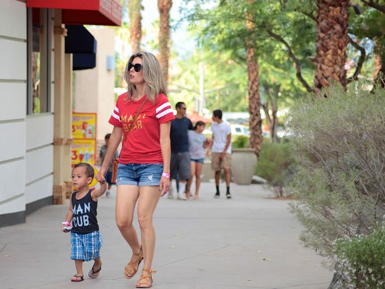 Customers browse through shops at The River in Rancho Mirage on Tuesday afternoon. Cheerland Investment Group purchased the Rancho Mirage shopping center last year, several storefronts remain empty. The shopping center on Highway 111, between Las Palmas and Bob Hope drives, is considered Rancho Mirage's downtown. It has struggled in recent years, especially with the departure of Borders bookstore in 2011. The center's new owner, CheerLand Investment Group, is working to revive the center — a task taking longer than they had expected.