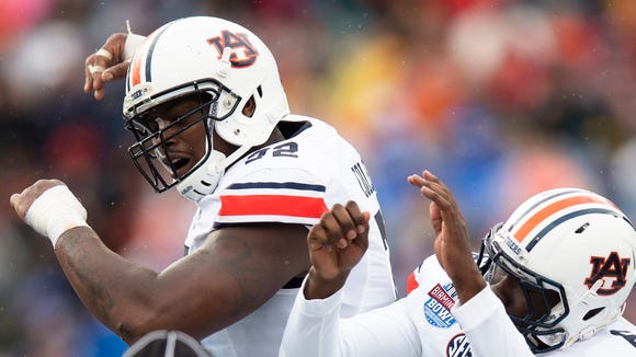 Auburn quarterback Jeremy Johnson (6) celebrates with Auburn offensive lineman Shon Coleman (72) after scoring a touchdown during the NCAA football game in the Birmingham Bowl on Wednesday, Dec. 30, 2015, at Legion Field in Birmingham, Ala.