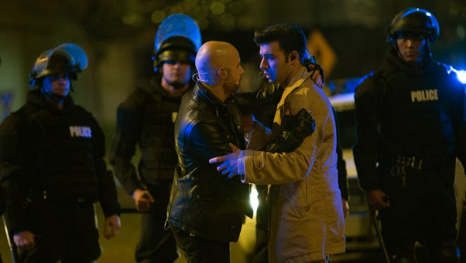 Judas (Chris Daughtry)  and Jesus (Jencarlos Canela) share a scene during rehearsals for 'The Passion.'