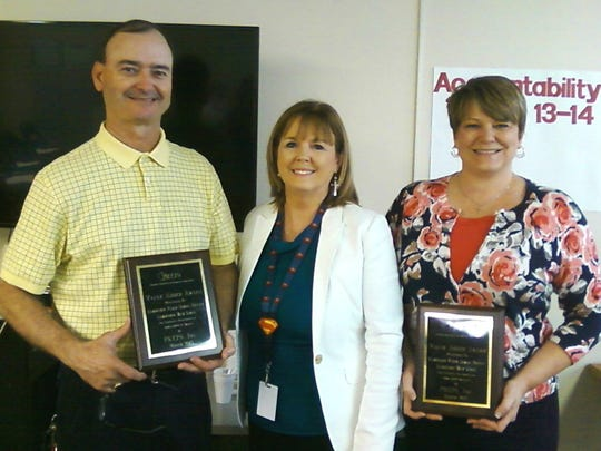Lumberton teachers Teresa Poston and Mason Smith were recognized for outstanding achievement on statewide tests, Poston for biology and Smith for U.S History. Pictured, from left, are Smith, Superintendent Linda L. Smith and Poston.