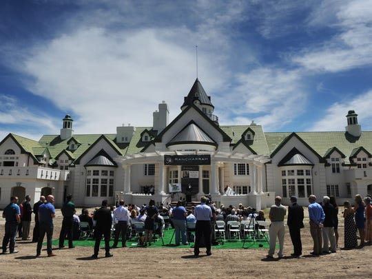 A crowd gathers during the groundbreaking ceremony