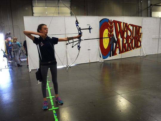 Holland Linterman takes aim while shooting at Wasting Arrows Archery in Reno on Tuesday.