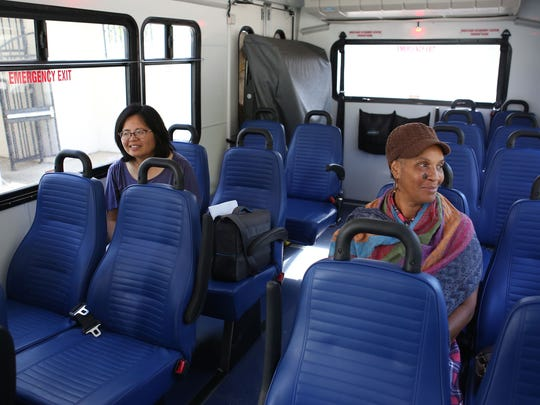 Sandra Carter, right, and Nancy Chen ride the Blythe Wellness Express to Desert Regional Medical Center in Palm Springs.