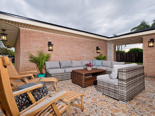 The homeowners totally remodeled  the backyard patio replacing the old concrete with large, decorative tiles, installed new outdoor lighting giving  the patio a whole new look.  It's  a great place to entertain.