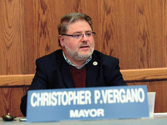 Mayor Chris Vergano and five members of the governing