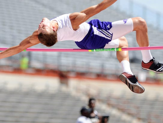 Cross Plains' Creed Goode stretches in an attempt to get over the bar during the Class 1A boys high jump, an event he won. He later added a second gold medal when he took the long jump.