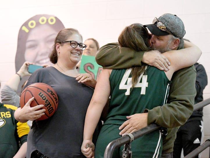 Wilson Memorial's Sarah Sondrol receives a hug from