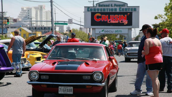 Classic and custom cars and trucks search for parking outside the Ocean City convention center during last year's Cruisin' Ocean City car show.