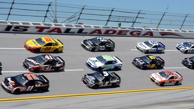 Denny Hamlin (11), leading a pack of cars during the Aaron's 499 in May, is the most recent winner at Talladega Superspeedway.