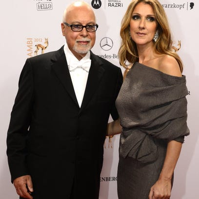 Celine Dion, show here during a charity event in Montreal last year, crosses her fingers when she discusses her husband René Angélil's cancer recurrence.