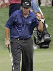 Phil Mickelson celebrates his birdie putt on the fourth hole during the final round of the PGA Championship at the Baltusrol in 2005.