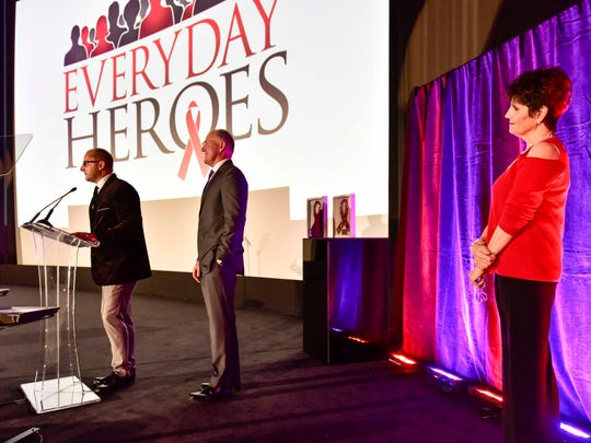 Jim Scheibel (left) and Tim Wood of State Farm Insurance present the Good Neighbor Award at Everyday Heroes on Dec. 1 at Camelot Theatres in Palm Springs as Lucie Arnaz looks on.