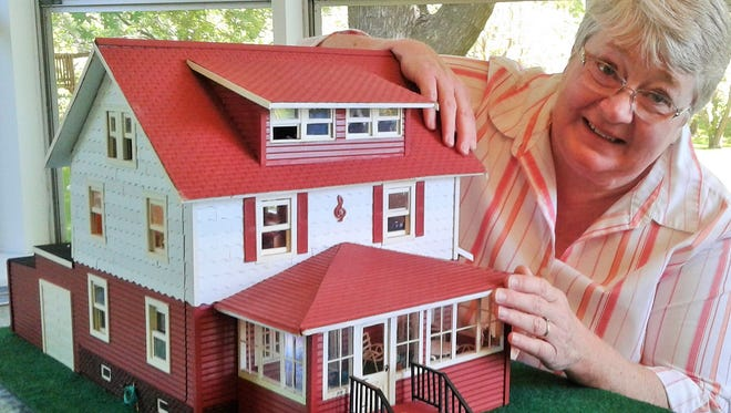 Iowa City band instructor Kathy Smith's decades-long project is building this exact scale model of her Cedar Rapids childhood home.
