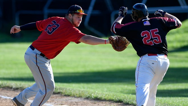 Manchester first baseman Adam Kipp is seen here in a file photo making the tag on a runner. Kipp had seven RBIs on Sunday in Manchester's 13-11 win over Pleasureville.