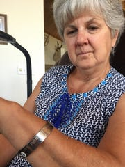 Debby Perry shows the POW/MIA bracelet she wore during