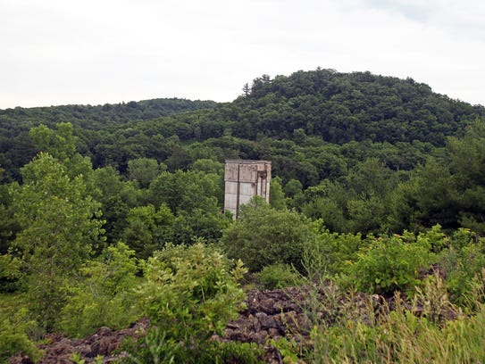 The start of a dam control tower still stands in the
