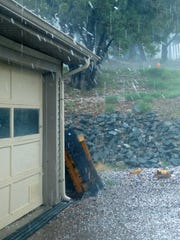 Hail hits a roof with such force Sunday that it bounces