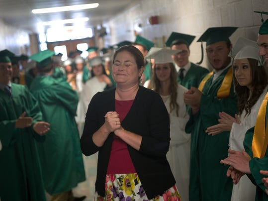 Fairfield English teacher Siri Phelps makes a speech to the graduates in the hallway about how much she has enjoyed teaching them and also warns them that she's about to get emotional on June 5.