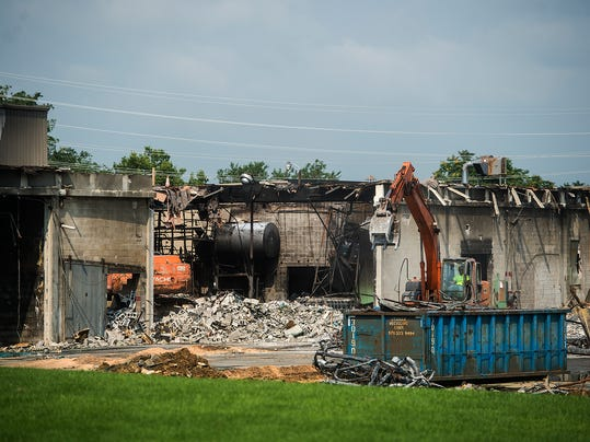 The remnants of Miller Chemical's facility are visible from High Street on July 7.