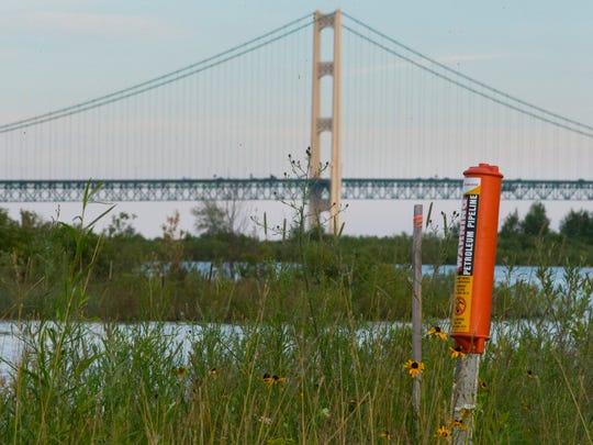 A marker on the north shore of Straits of Mackinac indicates where a pipeline enters the water Tuesday, July 25, 2017 in St. Ignace, Mich. Just west of the iconic bridge are two oil pipelines laid in 1953 that span the bottom of the Straits of Mackinac, the 5 mile-wide strip of water separating Lakes Michigan and Huron that is whipsawed by currents unlike anywhere else in the Great Lakes. The daily capacity of the oil pipeline are 540,000 barrels per day.